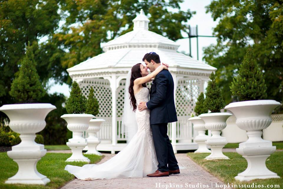 Your ceremony may also be held in one of our two outdoor gazebos with seating for over 250 guests amongst lush landscapes and our unique water features. The Mansion's courtyard features two gazebos, pristine landscaping, lush gardens, a waterfall, and a large pond with wooden walkway bridge.